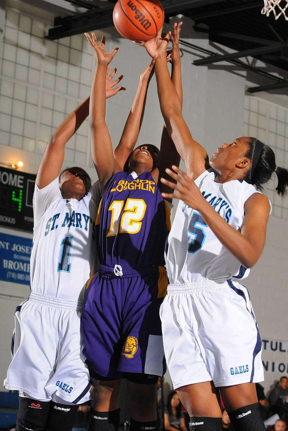 Bishop Loughlin's Imani Tate, center, goes up for