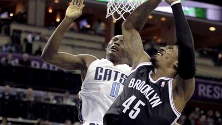 Nets' Gerald Wallace loses his balance as he