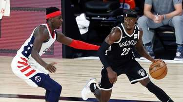 Nets guard Caris LeVert (22) dribbles against Washington