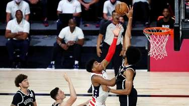 Nets center Jarrett Allen, right, blocks the shot