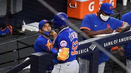 Mets manager Luis Rojas talks to Yoenis Cespedes