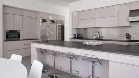 Lucite stools impart the finishing touch to this