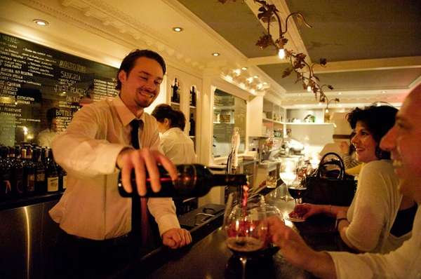 Bartender Drew Conroy pours a glass of wine