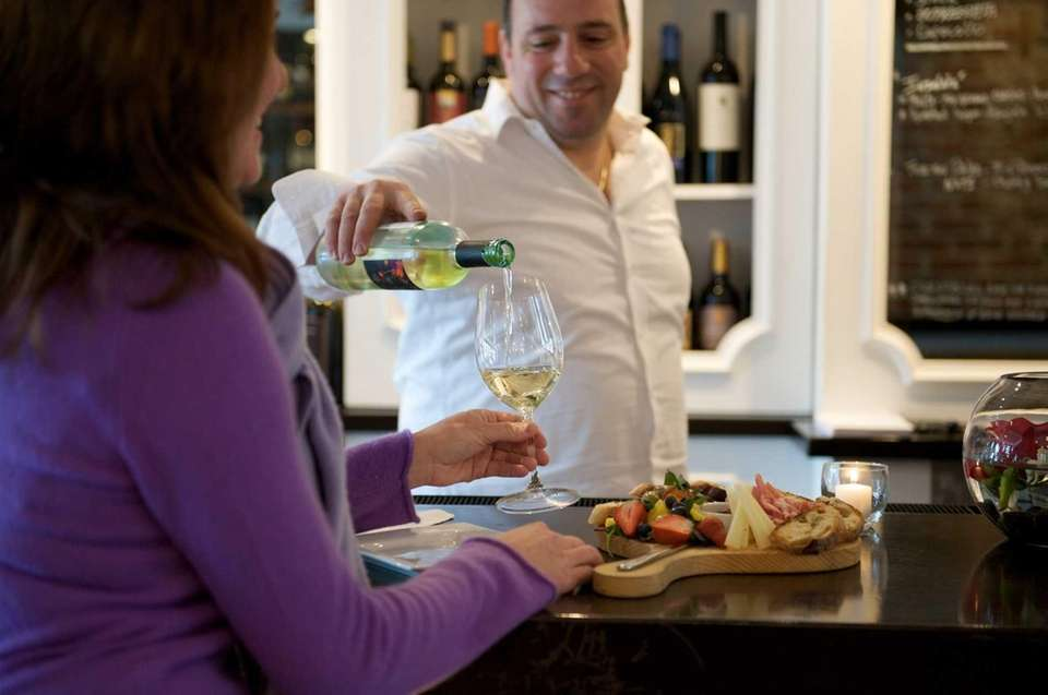 Molto Vino owner Massimiliano Gargiulo pours one of