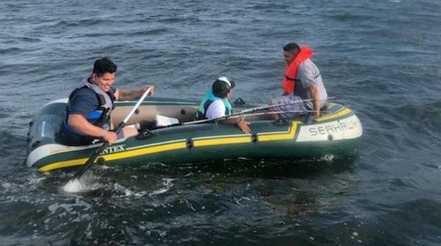 Three men on a raft in Long Island