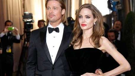 Angelina Jolie and actor Brad Pitt arrive at