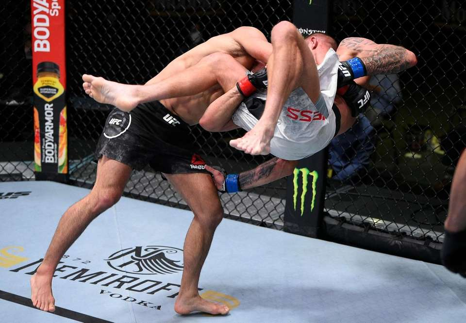 Johnny Munoz takes down Nate Maness in their