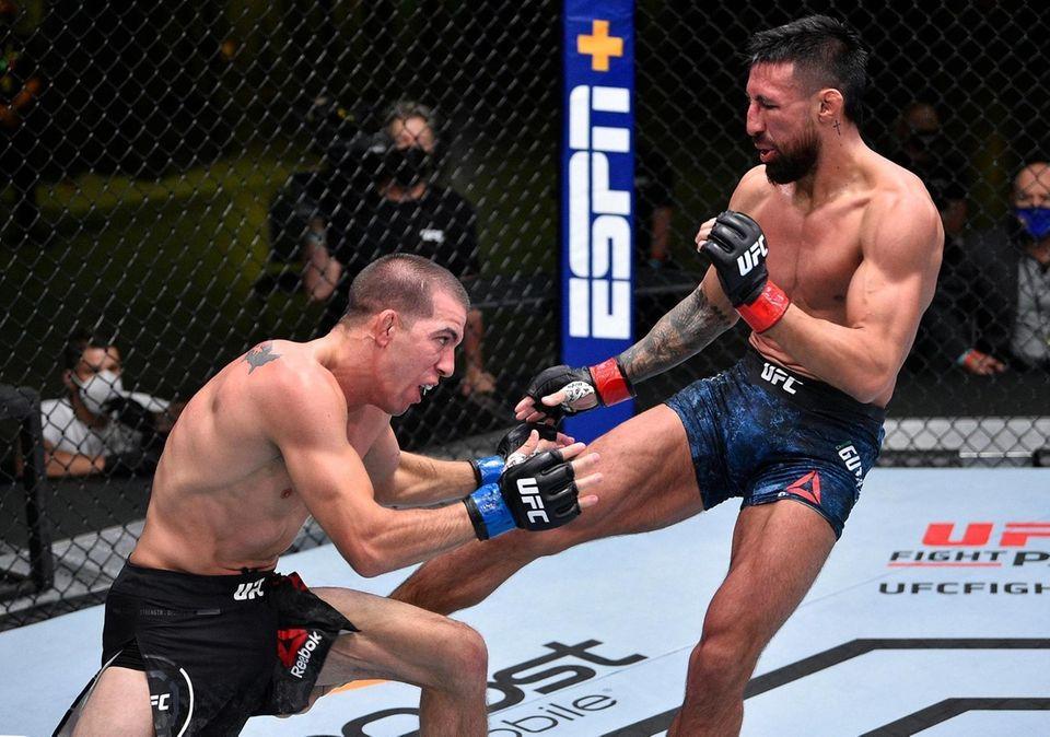 Chris Gutierrez kicks Cody Durden in their bantamweight