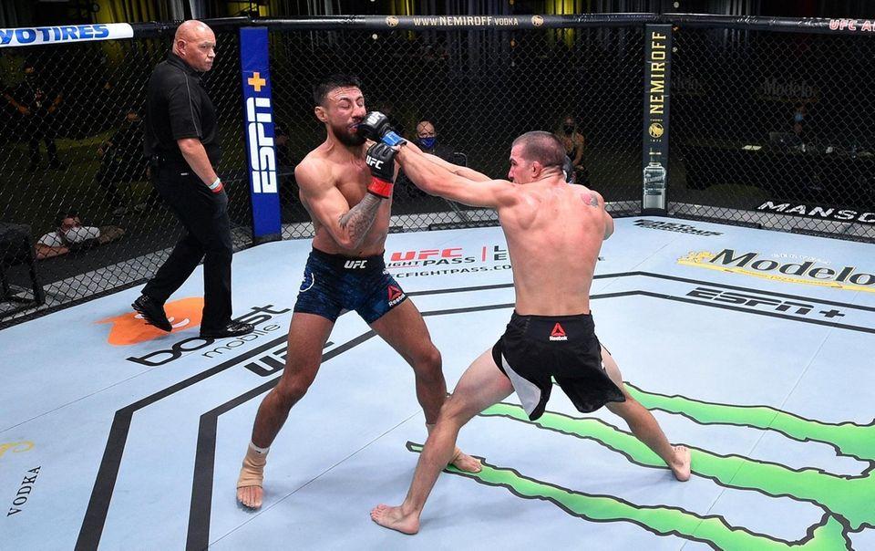 Cody Durden punches Chris Gutierrez in their bantamweight