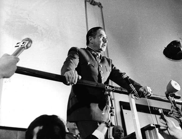 Chilean dictator Gen. Augusto Pinochet speaks at an