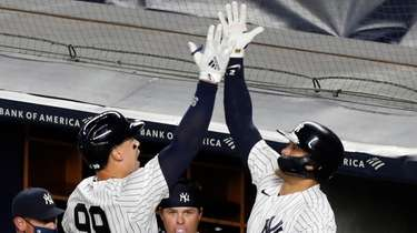 Yankees' Aaron Judge (99) celebrates with Giancarlo Stanton