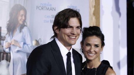 Ashton Kutcher and Demi Moore arrive at the