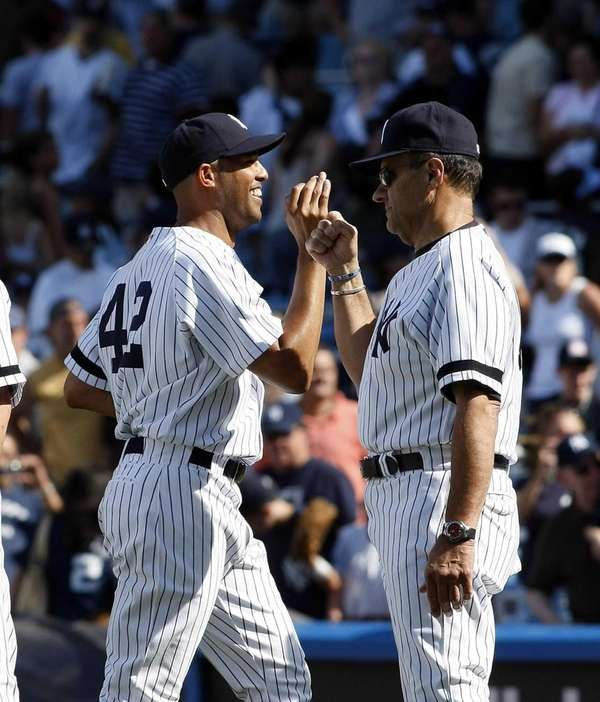 Mariano Rivera gets congratulations from Joe Torre after