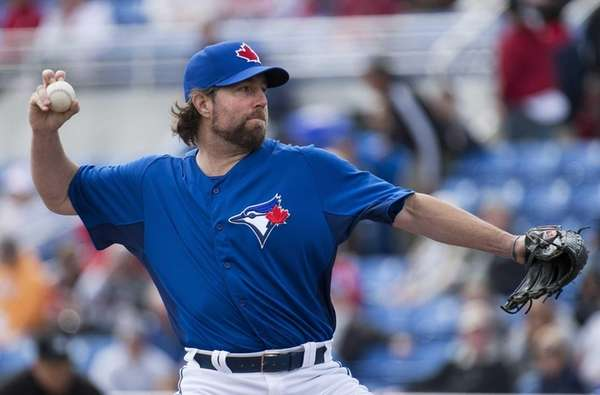 Toronto Blue Jays starting pitcher R.A. Dickey throws