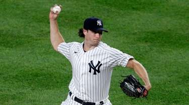 Gerrit Cole #45 of the Yankees pitches during