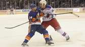 Brad Boyes of the Islanders collides with Taylor