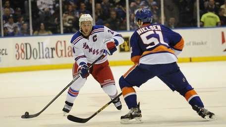 Ryan Callahan of the Rangers passes the puck