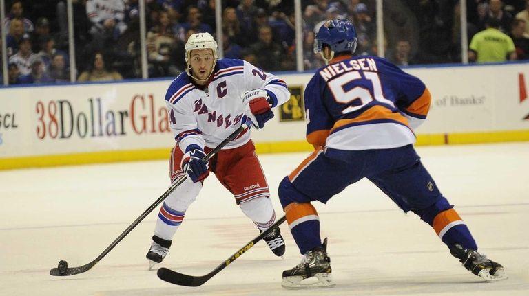 Ryan Callahan of the Rangers passes the puck