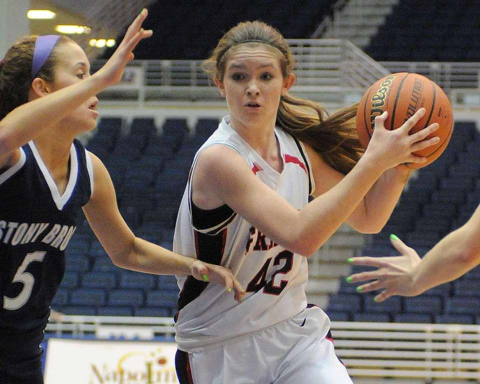 Friends Academy's Lindsay O'Sullivan, right, looks to drive