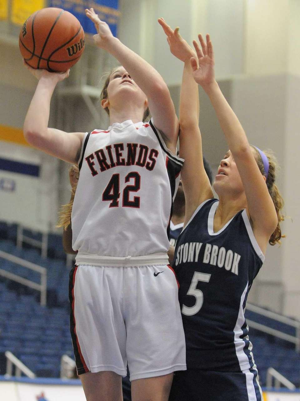 Friends Academy'sLindsay O'Sullivan drives to the basket during