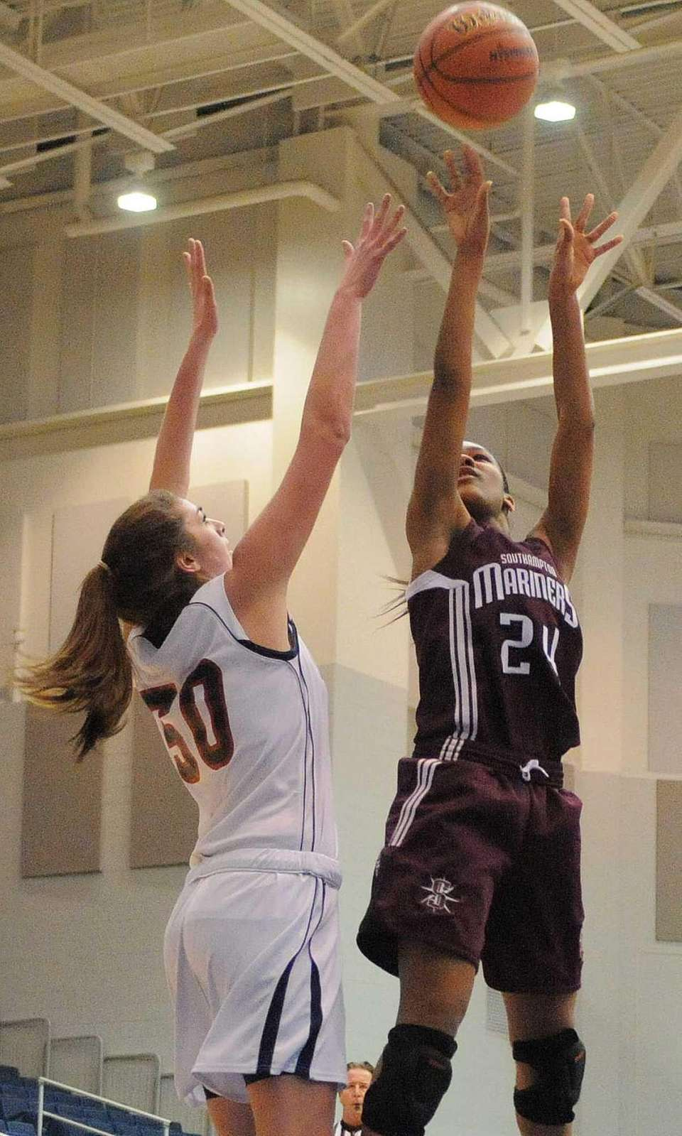 Southampton senior Paris Hodges, right, shoots a jumper
