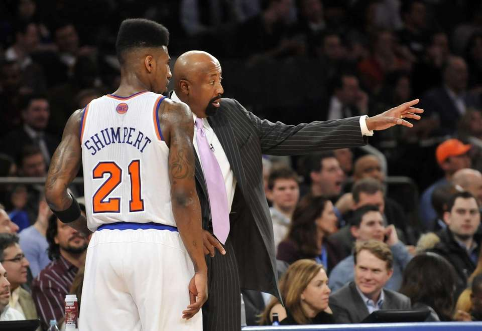 Iman Shumpert of the Knicks talks to coach