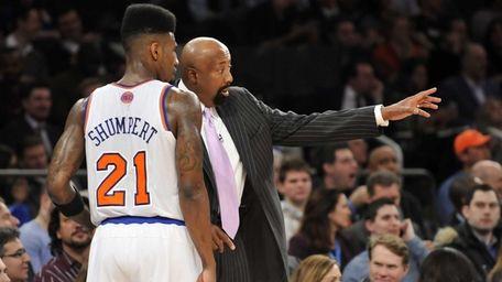 Iman Shumpert of the Knicks talks to coach