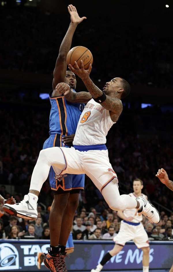 Knicks' J.R. Smith drives past Oklahoma City Thunder's