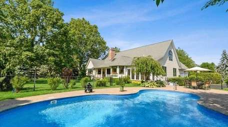 This four-bedroom, three-bath Postmodern house in Cutchogue, listed