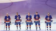 The New York Islanders stand for the National