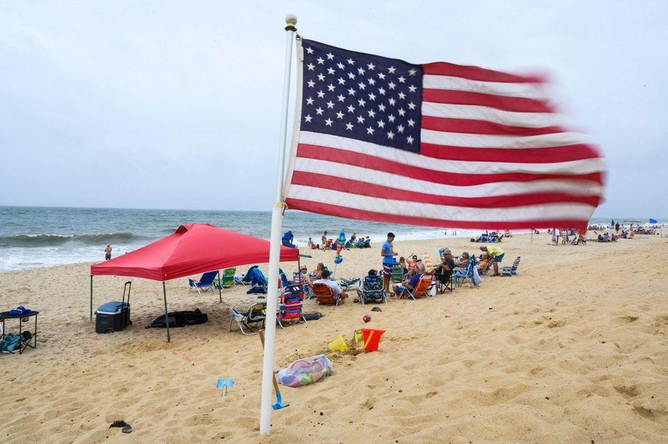 An American flag blows in a stiff breeze