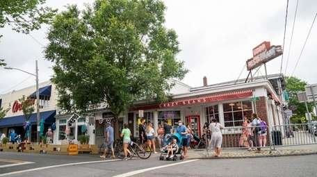 People on Front Street in Greenport on Tuesday.