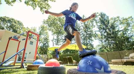 Clint Daly, 12, seen on an obstacle course