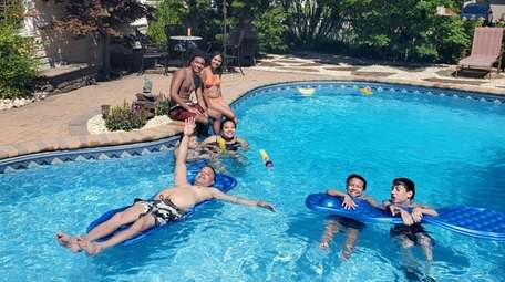 The Gonzalez family enjoys the pool they booked