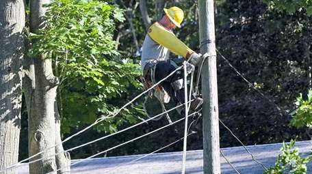A PSEG workers labors to restore power in