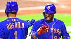 Robinson Cano of the Mets is congratulated by