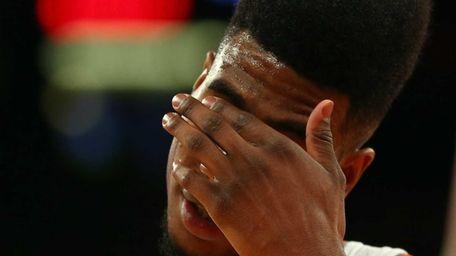 Iman Shumpert of the New York Knicks reacts