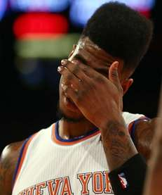 Iman Shumpert of the New York Knicks reacts