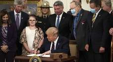 President Donald Trump signs the Great American Outdoors