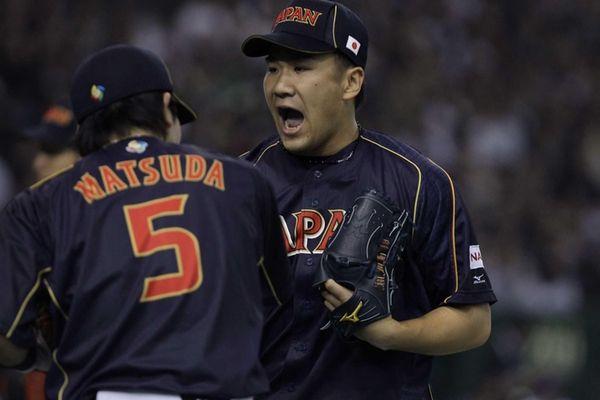 Pitcher Masahiro Tanaka of Japan reacts after the