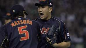 Pitcher Masahiro Tanaka of Japan reacts after the