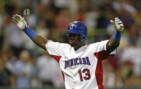 Dominican Republic's Hanley Ramirez celebrates after hitting a