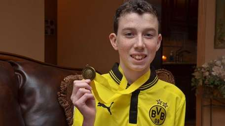 Eighth-grader Connor Madden, 13, won the school-level New