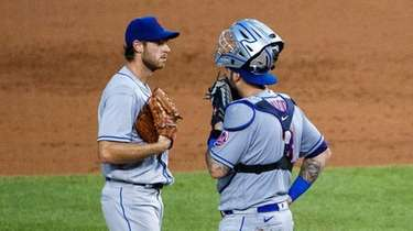 Mets starting pitcher Steven Matz talks with catcher