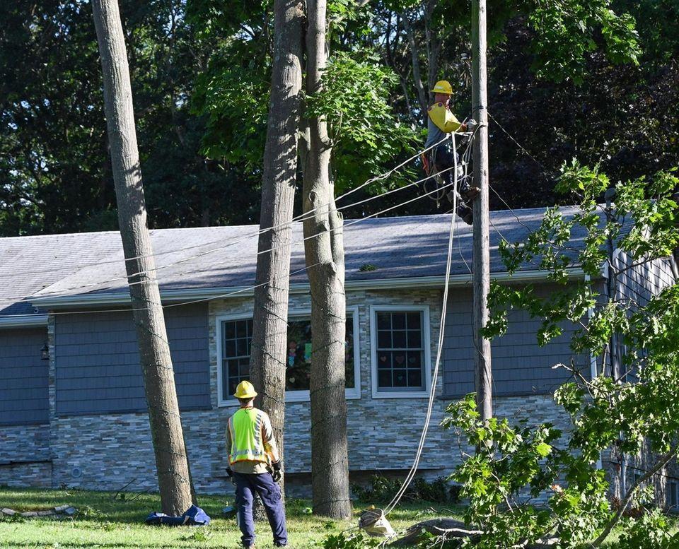 PSEG workers work on restoring power in front