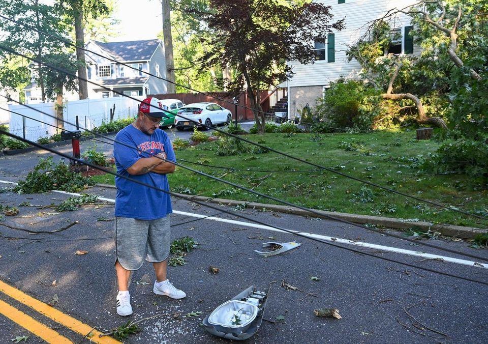 Scott Casagrande, in front of his home on