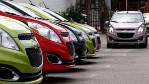 The 2013 Chevrolet Spark is shown during a