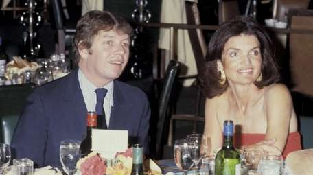 Pete Hamill and Jackie Onassis at a party