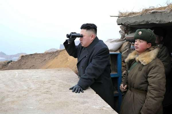 North Korean leader Kim Jong Un, center, uses