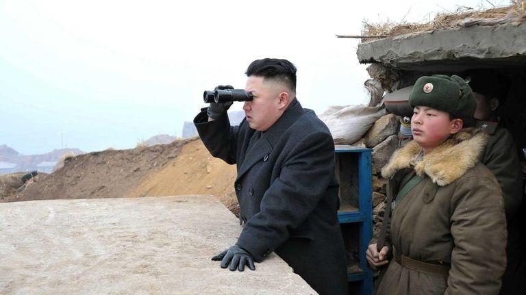 North Korean leader Kim Jong Un, center, uses